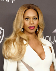 Laverne Cox wore her hair loose with a center part and gentle waves at the InStyle and Warner Bros. Golden Globes post-party.