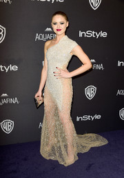 Kristina Bazan was a head turner in an embellished, sheer-bottom one-shoulder gown at the InStyle and Warner Bros. Golden Globes post-party.