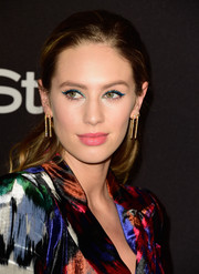 Dylan Penn totally embraced color, teaming blue cat-eye makeup with her multi-hued outfit.