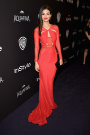 Victoria Justice oozed modern glamour in a flowing red cutout gown by Bao Tranchi at the InStyle and Warner Bros. Golden Globes post-party.