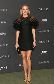 Gwyneth Paltrow looked festive in a black Gucci cocktail dress with ruffle sleeves and a geometric-sequined yoke during the 2016 LACMA Art + Film Gala.