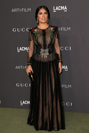 Salma Hayek donned a sheer, beaded Gucci gown with a nude underlay for the 2016 LACMA Art + Film Gala.