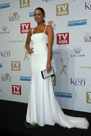 Monika Radulovic complemented her gown with a geometric-patterned box clutch.