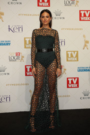 Jesinta Campbell put plenty of flesh on display in this green net gown by Camilla and Marc during the Logie Awards.