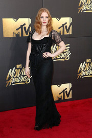 Jessica Chastain went for some vintage flair in a black lace peplum gown by Givenchy at the MTV Movie Awards.