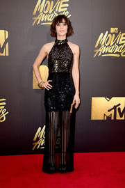 Lizzy Caplan shimmered in a paillette-embellished, sheer-bottom turtleneck gown by Sally LaPointe at the MTV Movie Awards.