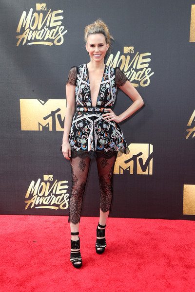 Black platform sandals with multiple perforated straps completed Keltie Knight's red carpet look.