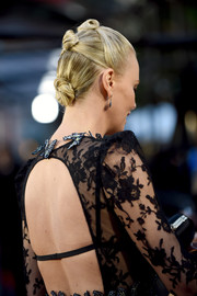 Charlize Theron slicked her hair back into a trio of knots for her MTV Movie Awards look.
