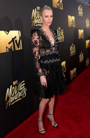 Charlize Theron ravished in a sheer black lace dress by Alexander McQueen at the MTV Movie Awards.