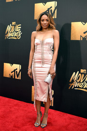 Kat Graham opted for metallic accessories, including a silver Oroton Frieze clutch.
