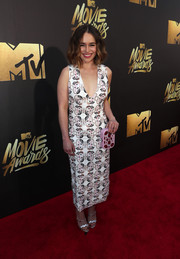 Emilia Clarke sealed off her look with a crystal-embellished clutch, also by Miu Miu.