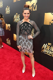 Katie Stevens showed off an ornately beaded and fringed dress at the MTV Movie Awards.