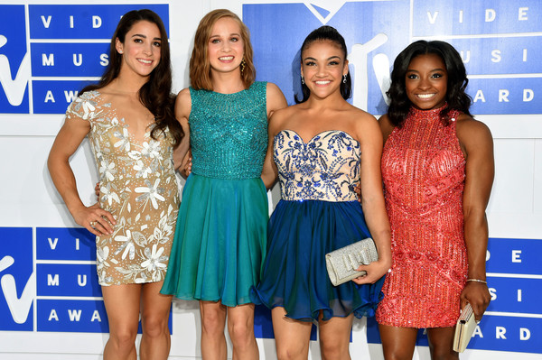 Olympic Gymnasts Aly Raisman, Madison Kocian, Laurie Hernandez and Simone Biles (in Sherri Hill)
