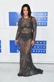 Ashley Graham put her voluptuous figure on display in a sheer pewter mesh gown by Naeem Khan at the 2016 MTV VMAs.