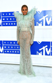 Beyonce Knowles made a diva-worthy entrance in a sheer mint-green Francesco Scognamiglio gown with an over-the-top feather neckline during the 2016 MTV VMAs.