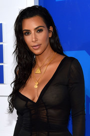 Kim Kardashian styled her LBD with layers of gold pendants.