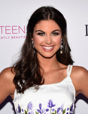 Katherine Haik wore a half-up hairstyle with curly ends at the 2016 Miss Teen USA competition.