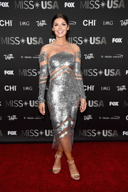 Ali Landry glittered all over the place in this silver illusion-panel sequin dress during the 2016 Miss USA competition.