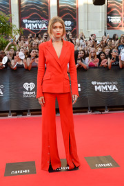 Gigi Hadid opted for a modern red Mugler pantsuit with slit ankles for the 2016 Much Music Video Awards.