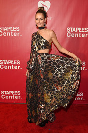 Nicole Trunfio made an appearance at the MusiCares Person of the Year event wearing a gold one-shoulder cutout gown.