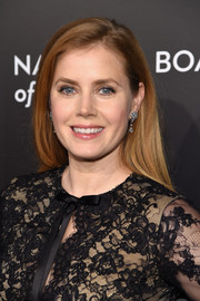 Amy Adams paired her simple 'do with dangling diamond earrings by Cartier for a more glamorous finish.