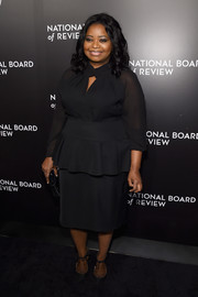 Octavia Spencer complemented her top with a black peplum skirt by Tadashi Shoji.
