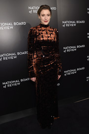 Greta Gerwig looked appropriately winter-glam in a figure-hugging bronze velvet gown by Prada at the National Board of Review Gala.
