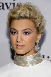 Tori Kelly wore her signature curls swept up in a loose bun during the Pre-Grammy Gala.