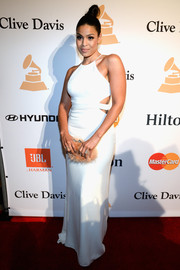 Jordin Sparks showed her bolder side in a figure-hugging white cutout gown during the Pre-Grammy Gala.