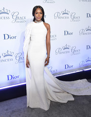 Naomi Campbell dropped jaws at the 2016 Princess Grace Awards Gala in a white Ralph & Russo fishtail gown with an embellished train cascading from one shoulder.