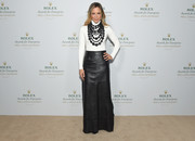Maria Bello completed her fall-chic look with a black leather maxi skirt.