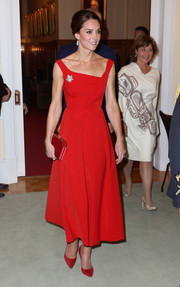 Kate Middleton amped up the elegance with a red satin clutch.