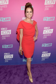 Brooke Burke-Charvet donned a gorgeous red cowl-neck dress with an open back and cape detailing for the TV Land Icon Awards.