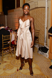 Lupita Nyong'o looked fetching at the 2016 Tony Awards Gala in a champagne-hued slip dress by Boss, featuring a cascade of ruffles down the front.
