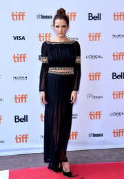 Riley Keough looked divine in a sheer, pleated gown by Chanel, featuring gold beading and cutouts along the midsection and sleeves, during the TIFF premiere of 'American Honey.'