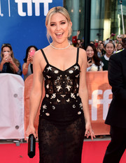 Kate Hudson paired a black Lee Savage tube clutch with a sheer lace dress for the TIFF premiere of 'Deepwater Horizon.'