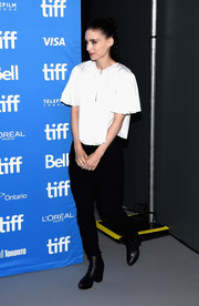 Rooney Mara contrasted her girly top with edgy black ankle boots.