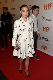 Natalie Portman opted for a beaded white coat dress by Christian Dior when she attended the TIFF premiere of 'Planetarium.'