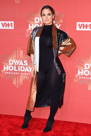 Jojo styled her slinky catsuit with a paneled sequin coat.