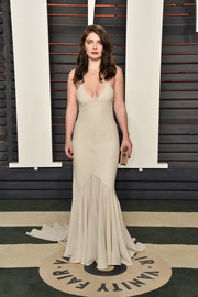 Eve Hewson showed her more daring side with this cleavage-baring nude mermaid gown by Houghton at the Vanity Fair Oscar party.