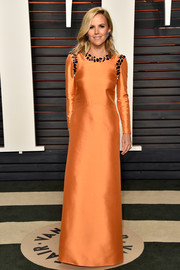 Tory Burch donned an orange silk gown with a stone-embellished neckline and shoulders for the Vanity Fair Oscar party.