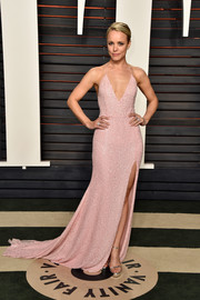 Rachel McAdams slipped into a pink Naeem Khan halter dress with a plunging neckline and a high slit for the Vanity Fair Oscar party.