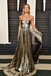 Kate Hudson dazzled in a golden Maria Lucia Hohan gown.