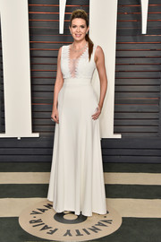 Carly Steel flashed major cleavage in a sheer-panel white gown by Black Halo at the Vanity Fair Oscar party.