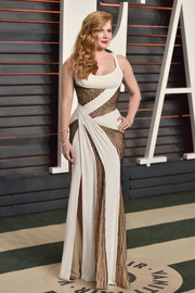 Amy Adams made an ultra-sexy statement at the Vanity Fair Oscar party with this custom Atelier Versace monochrome gown with sheer-illusion mesh panels.