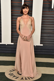 Aubrey Plaza was boudoir-chic at the Vanity Fair Oscar party in a blush and nude V-neck gown by Vionnet.