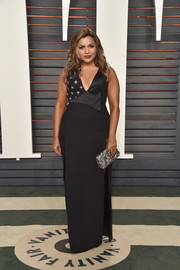 Mindy Kaling vamped it up in a deep-V, high-slit black gown by Salvador Perez at the Vanity Fair Oscar party.