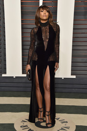 Gabrielle Union attended the Vanity Fair Oscar party looking super vampy in a curve-hugging black gown with a mesh-panel bodice and double slits.