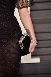 Demi Lovato arrived for the event carrying a chic black velvet clutch by Dolce & Gabbana.