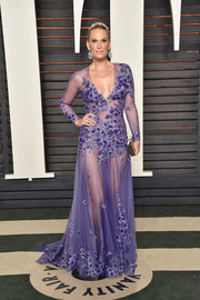 Molly Sims was a sexy head-turner at the Vanity Fair Oscar party in her sheer purple Tadashi Shoji gown.